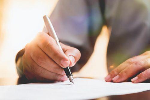 Atlanta estate planning lawyer signing paperwork